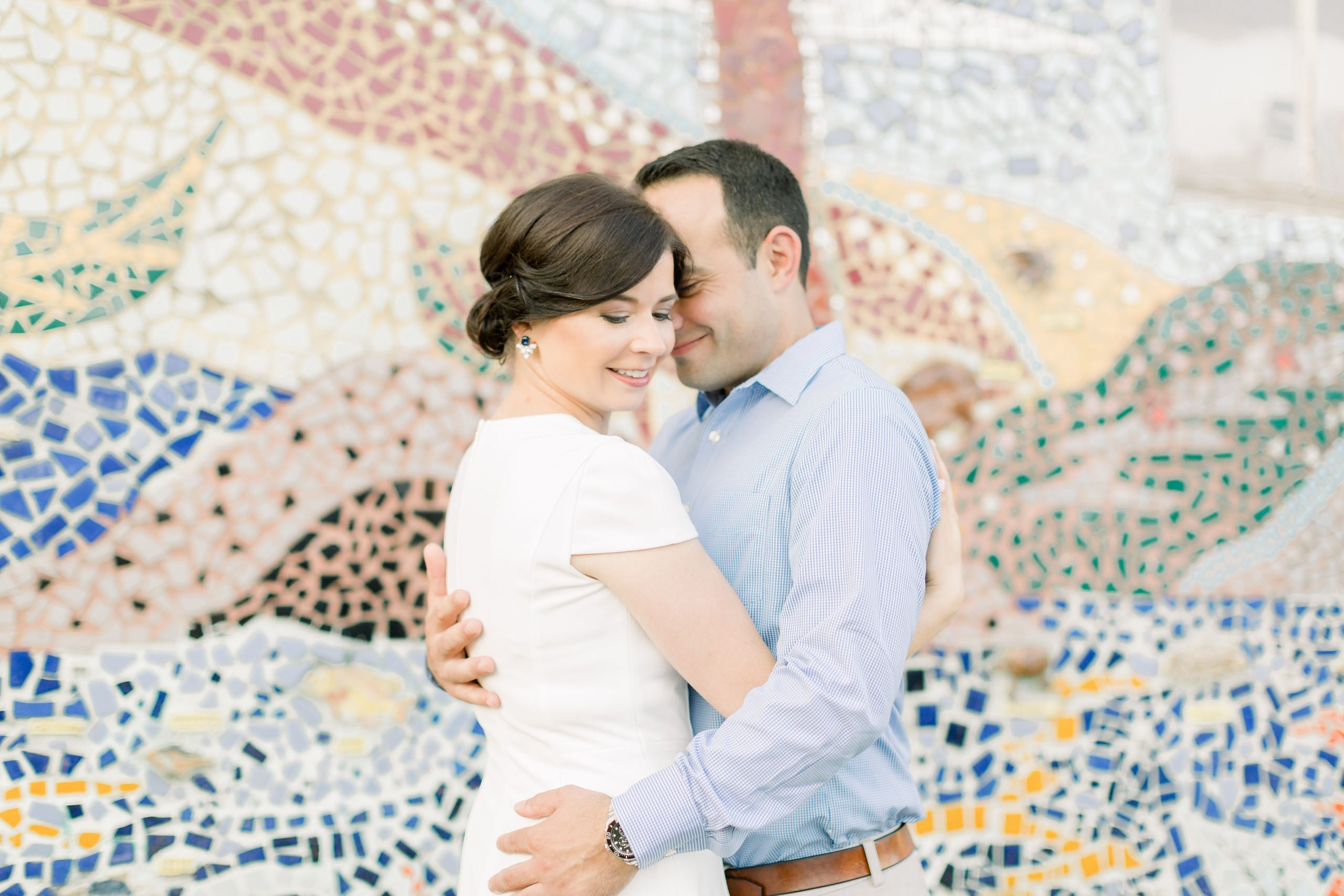 Couple Engagement Photo by mosaic wall